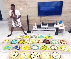 Mavin act, Reekado Banks turns 25 today and to celebrate him, his elder brother who also doubles as his manager got him 25 cakes.