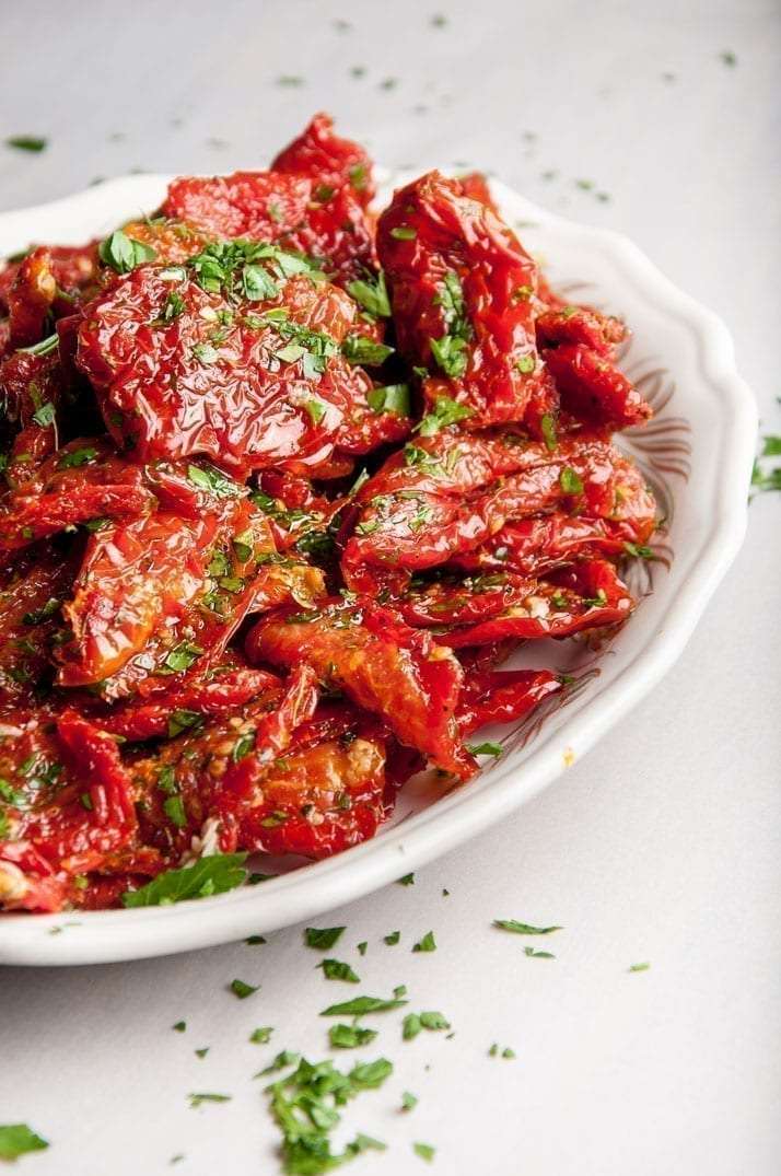 If you have made your own sundried tomatoes or bought a bag of them you will want to dress them before eating. Nonna Olga shows us how and what to add.