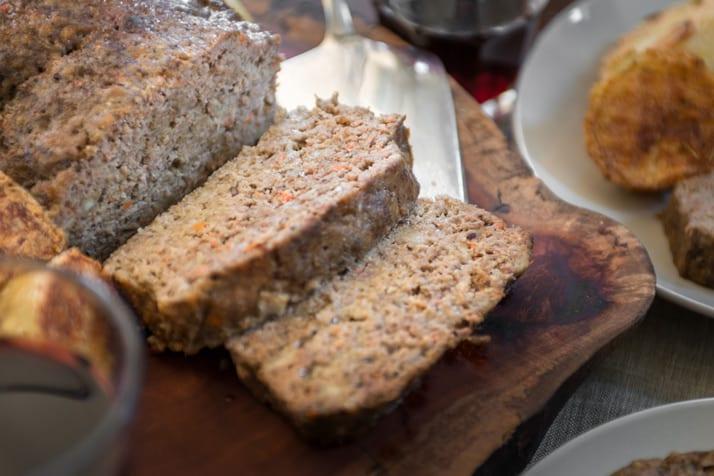 slicing italian meatloaf on platter