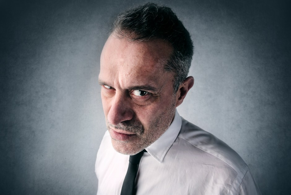 Angry businessman looking straight into the camera