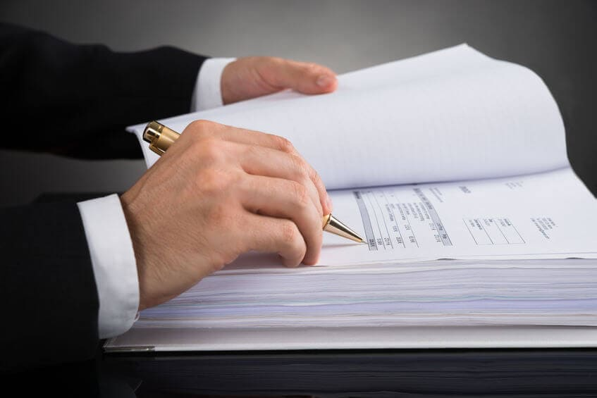 businessman hands writing on a large form
