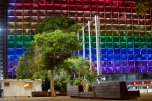 Tel-Aviv city hall lit up with rainbow flag colors in solidarity with Florida's shooting attack victims, in Tel Aviv, Israel, Sunday, June 12, 2016. The shooting attack in Orlando, Florida, USA, Sunday, left more than 50 people dead amid a multitude of events celebrating LGBT Pride Month. (AP Photo/Oded Balilty)