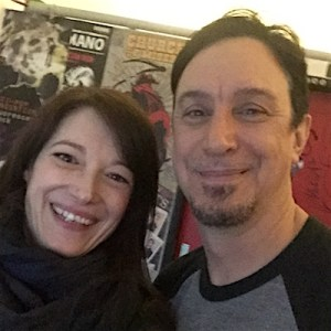 Left: Monica Mel of Global Rockstar (smiling) – Right: Lou Koller (smiling)