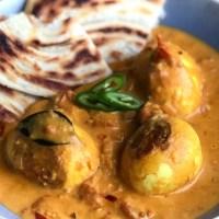 Indiase eiercurry met kokosmelk en tomaat