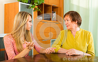 mother-daughter-talking-seriously-adult-having-serious-conversation-table-47157524