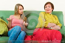 mother-daughter-talking-seriously-elderly-adult-sitting-sofa-having-serious-conversation-41992519