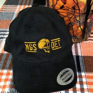 A black, adjustable baseball cap, with the Northern Guard logo in gold along the front.