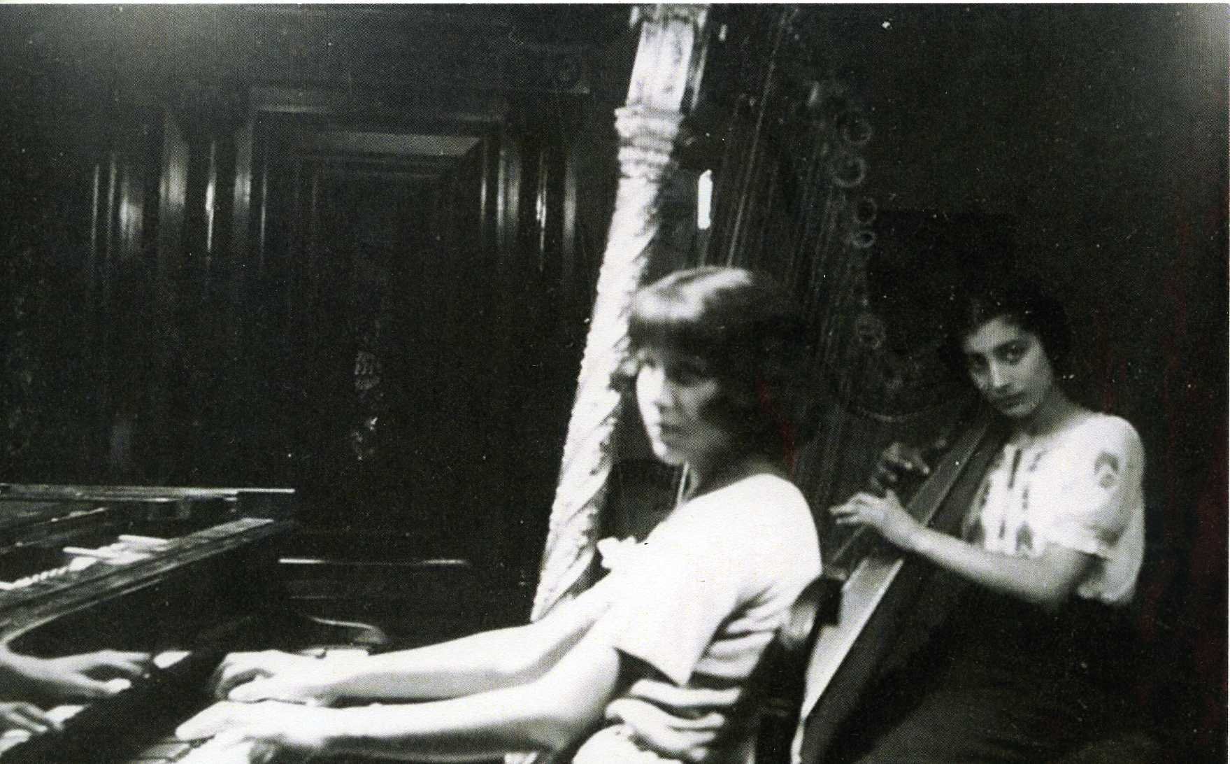 Khairunissa playing piano and Noor playing harp.