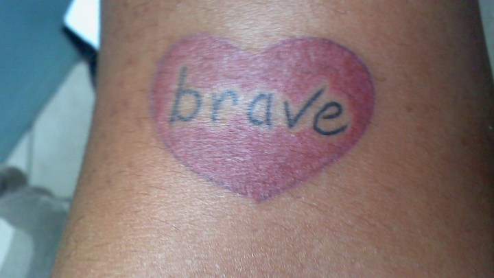 A tattoo of a heart with the word brave. Photo by: tanjila ahmed, Creative Commons