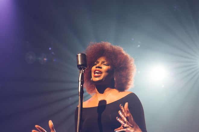 A woman sings on stage in this image by Josh Rocklage
