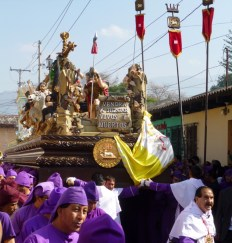 carrying the andus and statues for Lent procession - Antigua