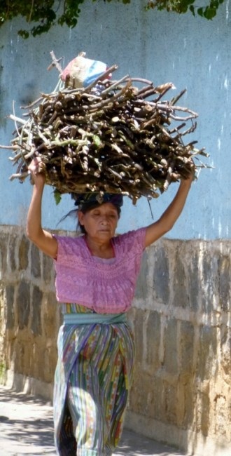 A woman with firewood in San Juan La Laguna,Guatemala