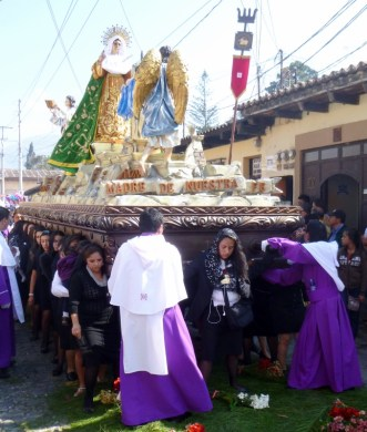 women carrying the andus and statues for a Lent procession - Antigua