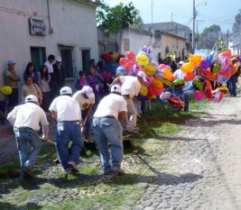 street sweepers clean up after a procession - Antigua