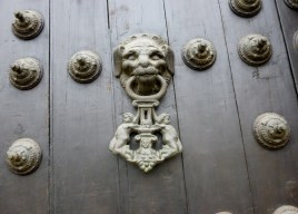 a door knocker with naked little critters