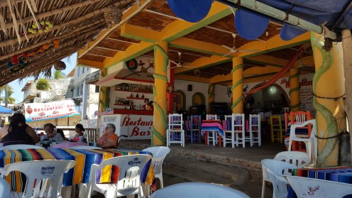 """Beach bar in Guayabitos.... I wish I'd taken a photo of the bathrooms here. So mad I forgot to. The toilets didn't have any water in them. There was a big rain barrel with a house outside of the """"room"""" where the toilet was (more like a closet)."""