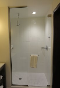 Nice big glass shower, but the water dribbles out of the spout by gravity alone.
