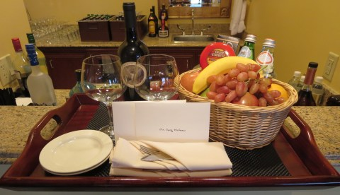 Fruit, cheese, wine, sparking water and two notes from the staff.