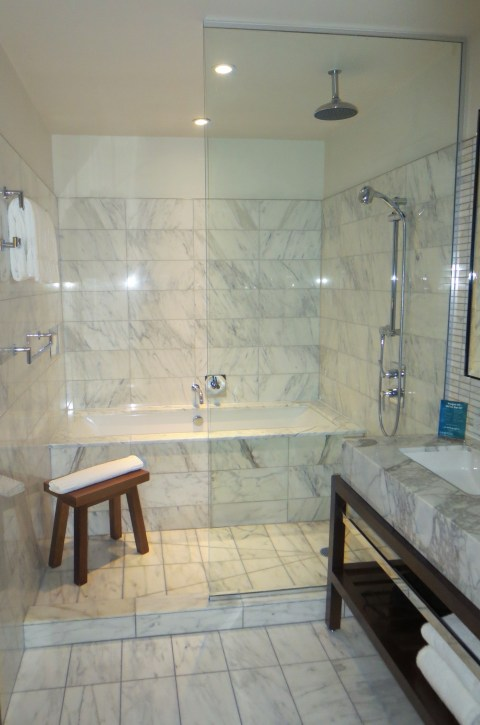 Two headed marble shower complete with bench