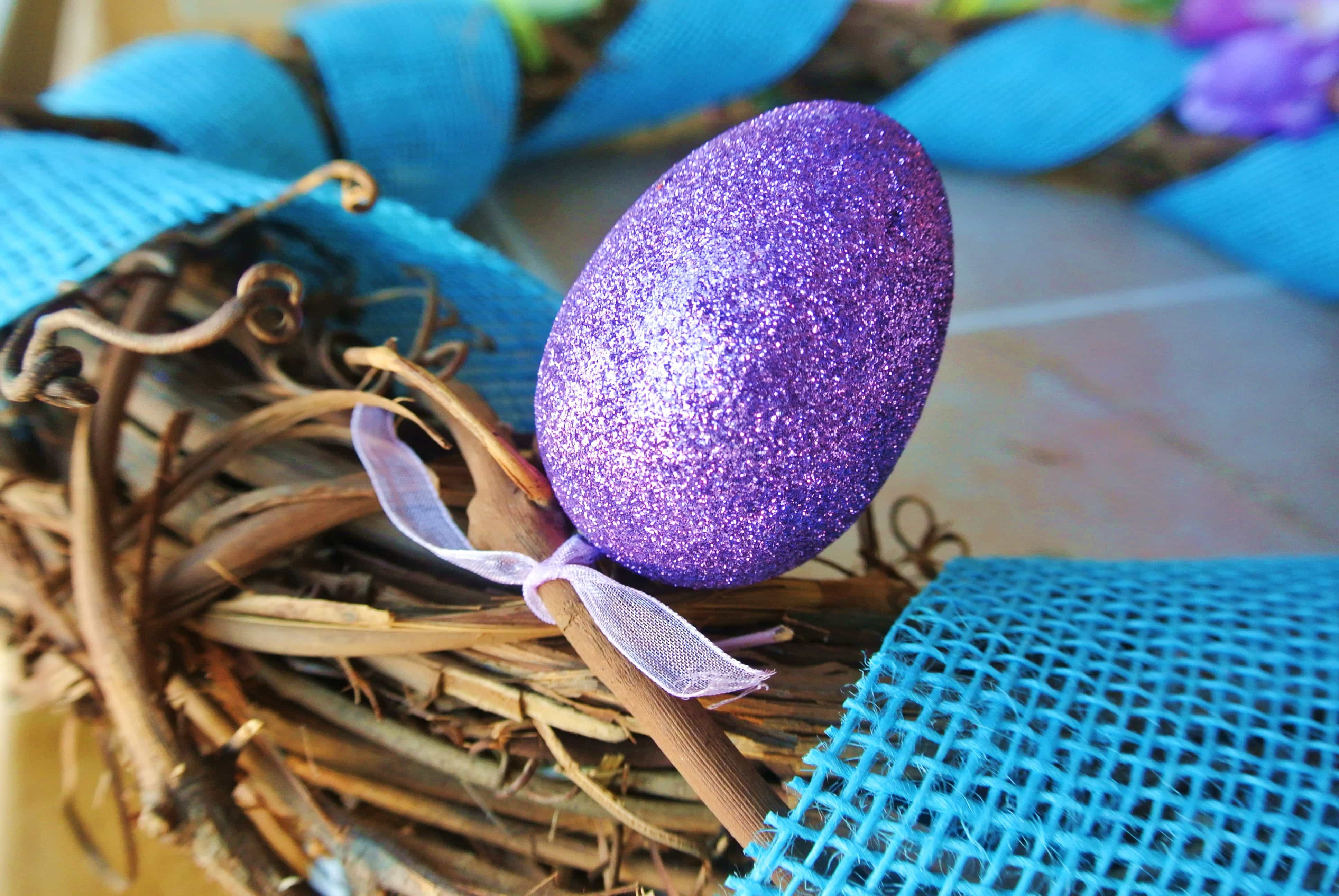 Tie eggs to grape vines in a clusters of three Placed a few inches apart in between gaps of burlap ribbon.