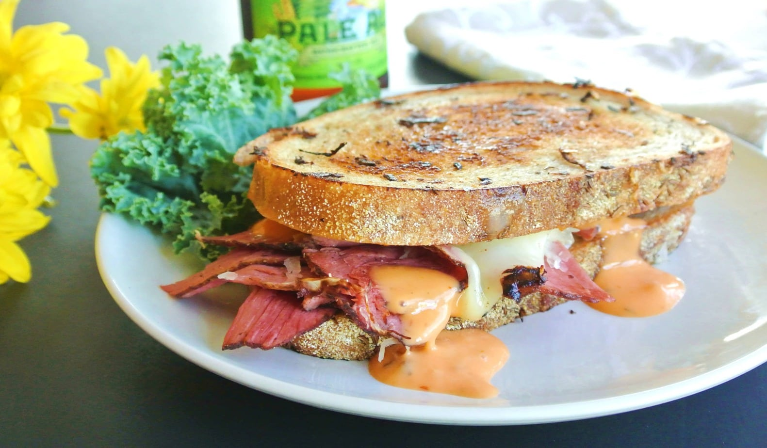 Make this classic grilled Reuben Pastrami on Rye Bread Sandwich recipe at home! All you need is sauerkraut, Swiss cheese and Russian dressing! It's easy!