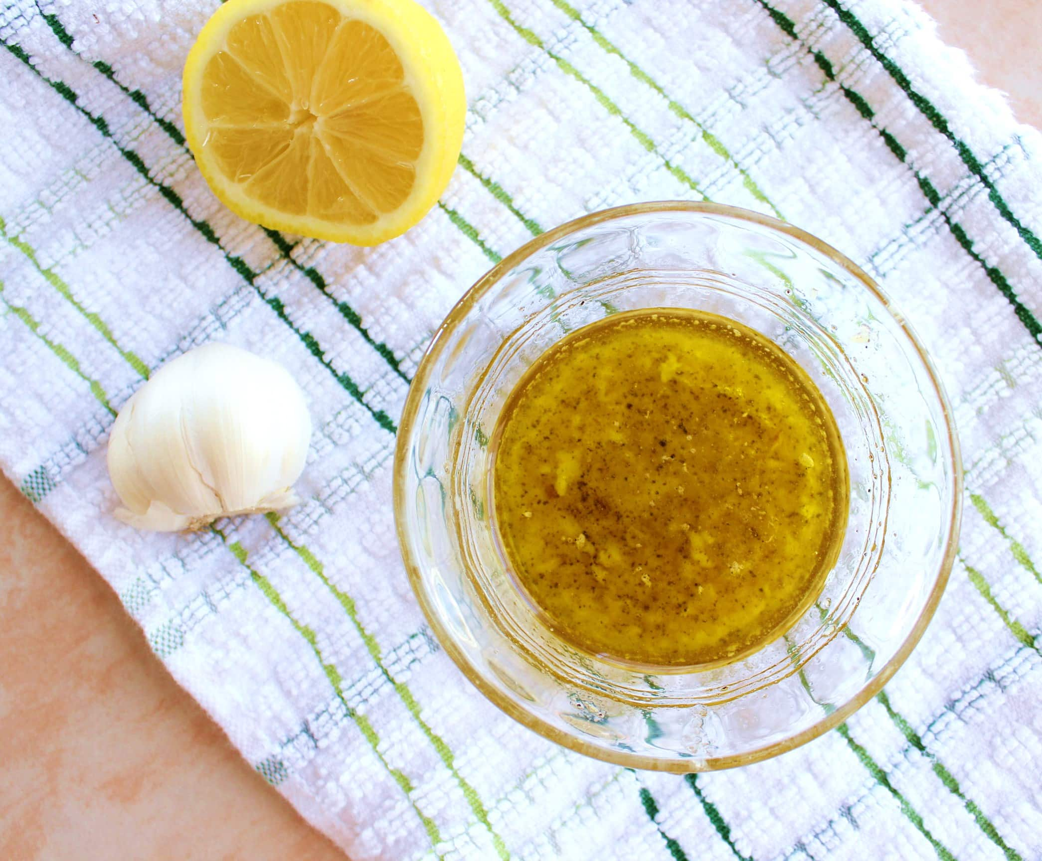 Extra virgin olive oil, fresh minced garlic, lemon juice and zest, honey, freshly cracked black pepper