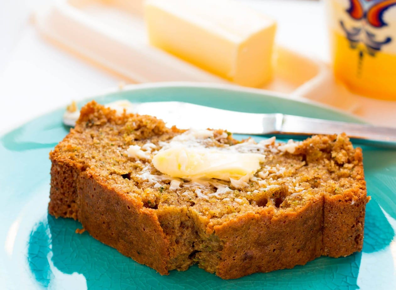 Best Moist Orange Zucchini Bread is made with orange zest and juice with ground cloves and cinnamon to take your zucchini bread to the next level! Delicious