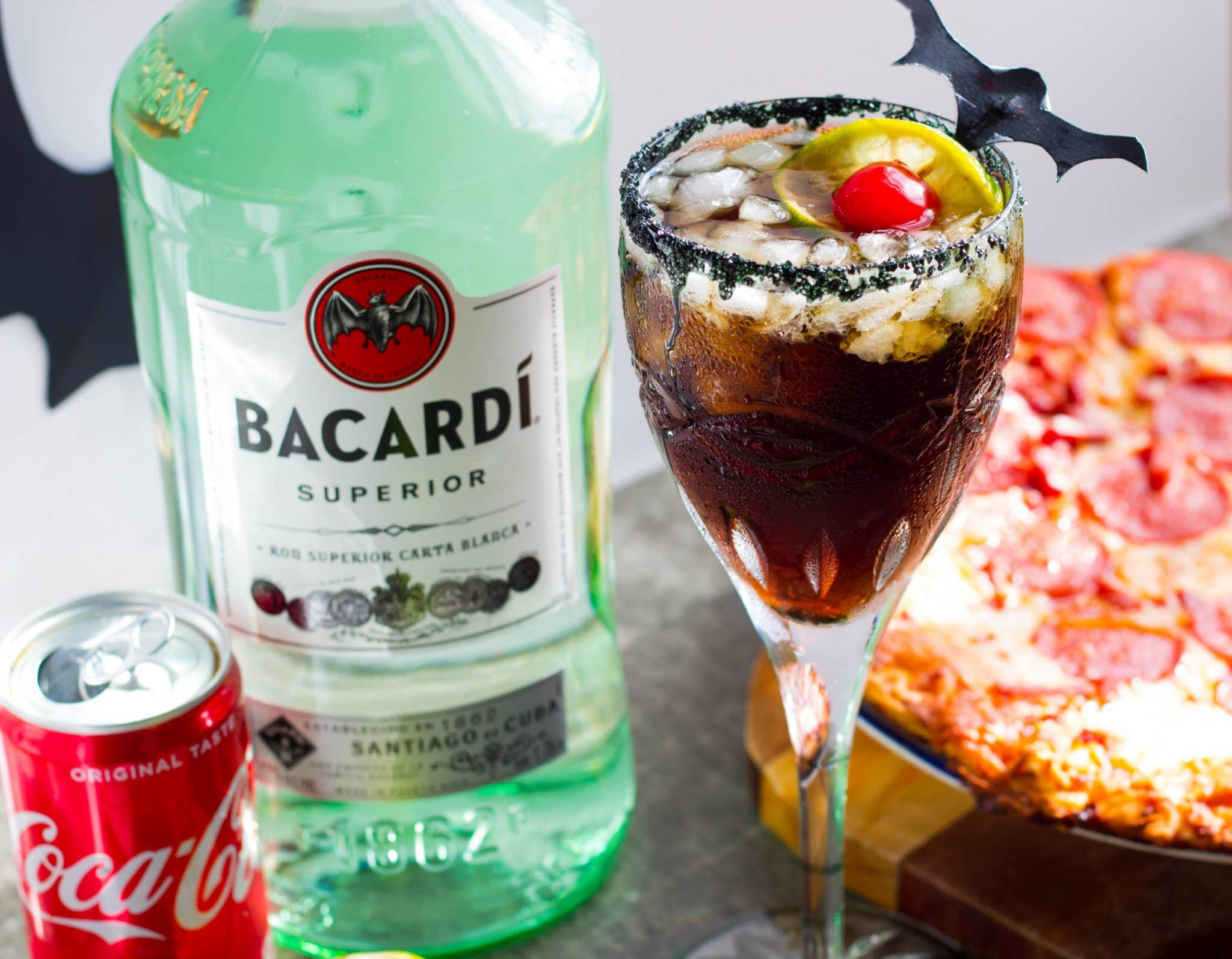 "BACARDÍ® rum & Coke Bat Tears Halloween Cocktail forms cool ""bat tears"" with condensation and black sugar crystals that's perfect for your Halloween party!"