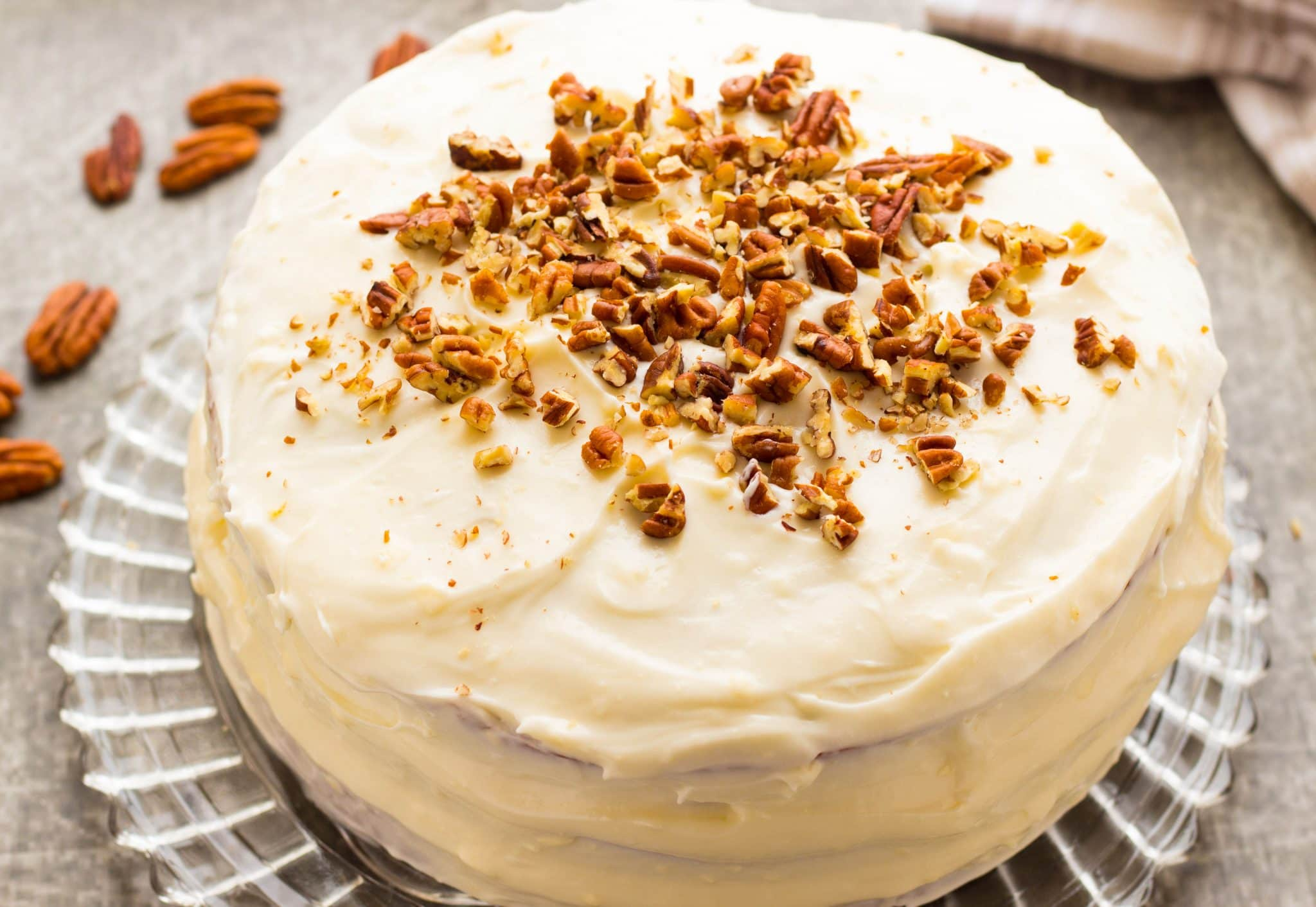 A southern favorite...Southern Hummingbird Cake is dense, moist, rich banana cake with crushed pineapple, roasted pecans & a buttery cream cheese frosting!