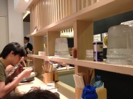 The interior of Shichisai Menya suggests a combination of old and new Japan, with IKEA.