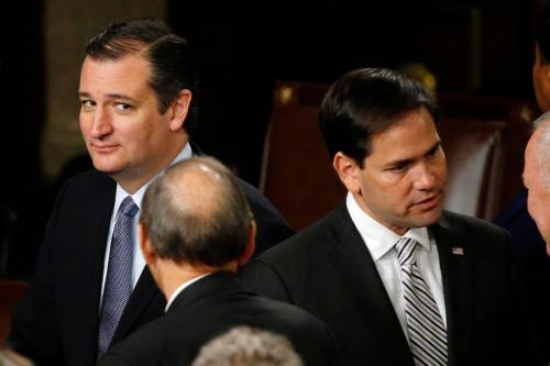 Republican U.S. presidential candidate and Senator Ted Cruz (L) looks over at rival candidate Senator Marco Rubio (2nd R) after Pope Francis' address before a joint meeting of the U.S. Congress in the House of Representatives Chamber on Capitol Hill in Washington September 24, 2015. REUTERS/James Lawler Duggan  - RTX1SAE2