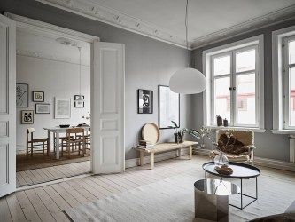living room interior apartment grey touch natural scandinavian serene lapine coco swedish via sophisticated tour furniture elegance effortless neutral tones