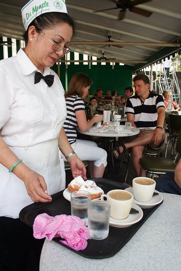 Beignets at Café du monde. The café opened its doors in the 1860s. And has ever since been the place for café au lait and beignets. The latter is ways served in pairs of three