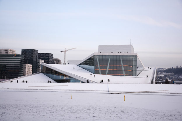 The Norwegian National Opera and Ballet surrounded by the icy Oslo Fjord.