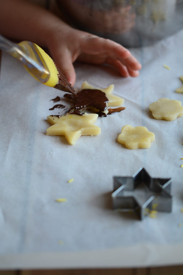 Painting the marzipan stars with chocolate