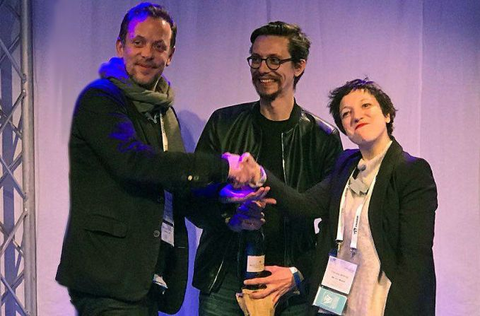 Nordic Game's Jacob Riis (left) congratulates We Are Müesli's Matteo Pozzi and Claudia Molinari