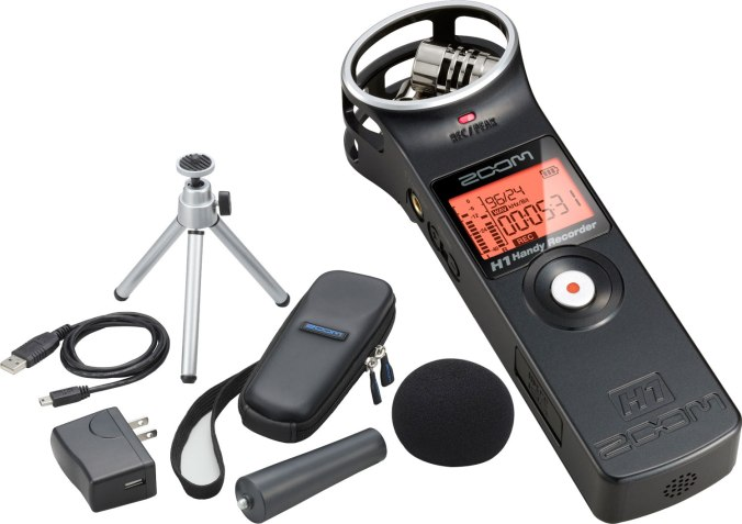 Zoom H1 audio recorder with accessories.