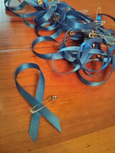 Blue ribbons tied with a safety pin