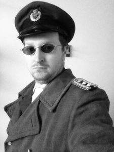 photo of a man in vintage military coat and hat