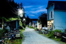 The main street of Tenakee during a twilght June night