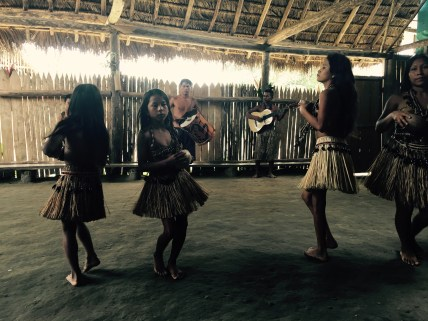 Quechua community dancing and playing music