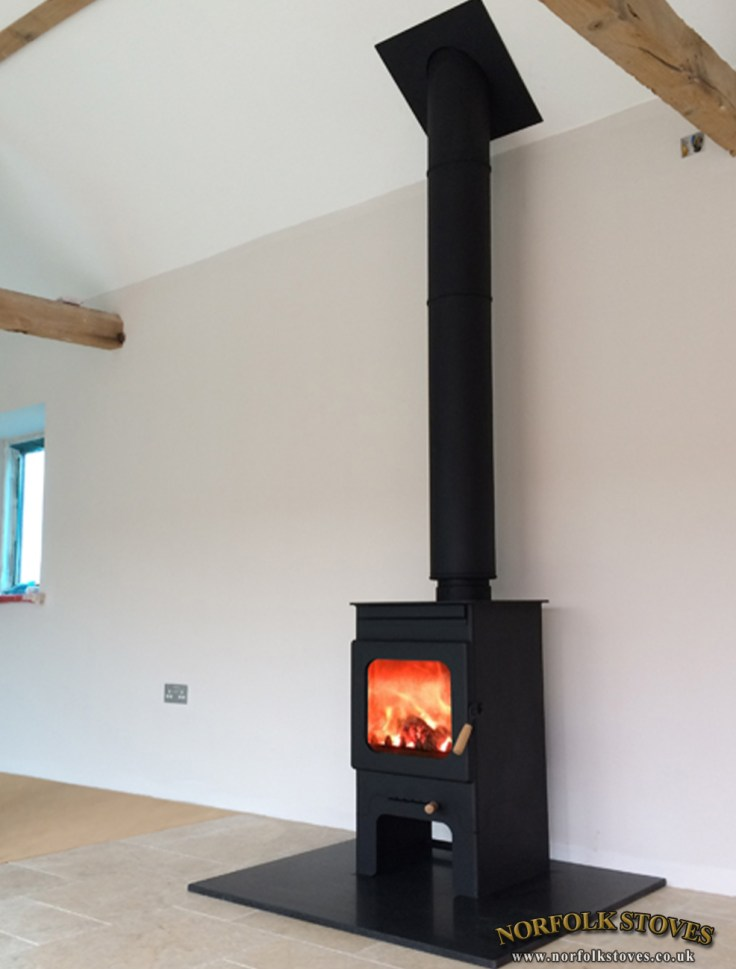 Burley Hollywell on Stand with a granite hearth. Professional XQ Chimney System fitted through a vaulted roof.
