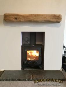 Yeoman Exmoor wood burning stove with wood beam