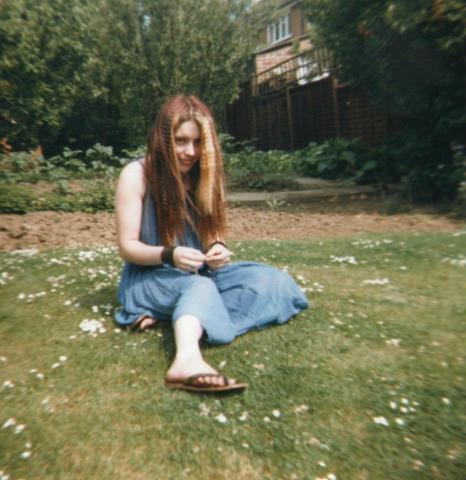 Goth girl in garden, in the 1980's