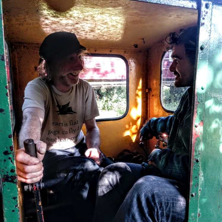 Two boys on a steam train