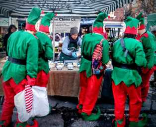 Elves at the cheese tasting stall