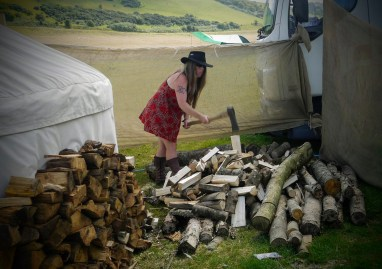 The writer chopping a pile of wood with a hand axe