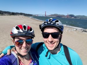 Biking Livergoods on the beach with Golden Gate Bridge in background