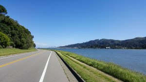 Bike path to Tiburon, CA with Sausalito, CA and San Francisco, CA skyline in distance. Richardson Bay to the right.