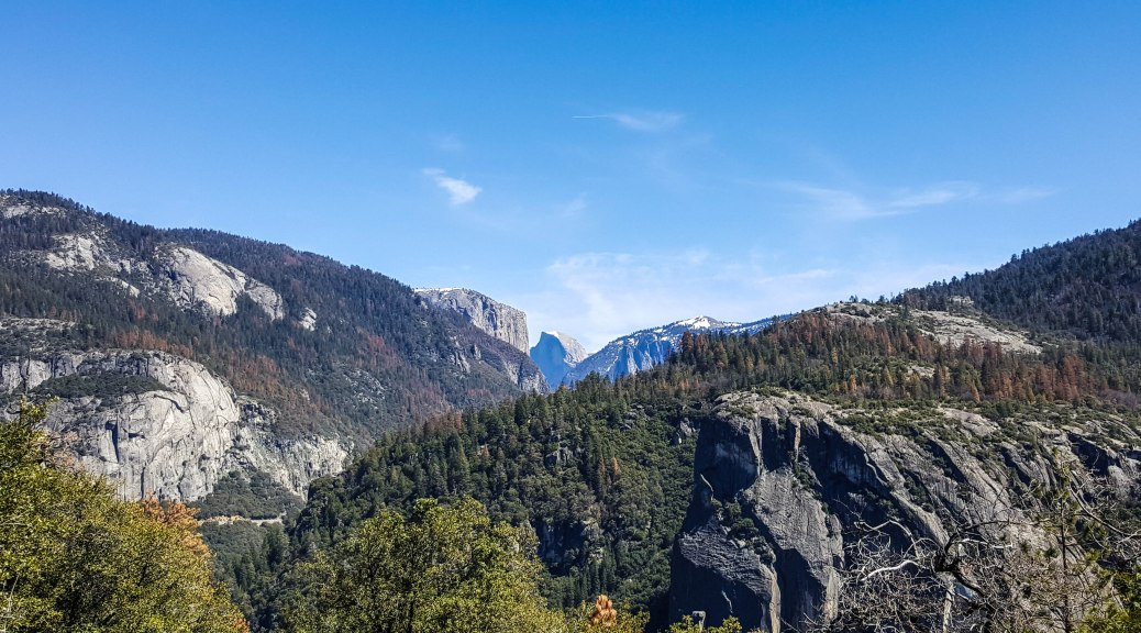 First view of Half Dome driving into Yosemite Valley on Hwy 120